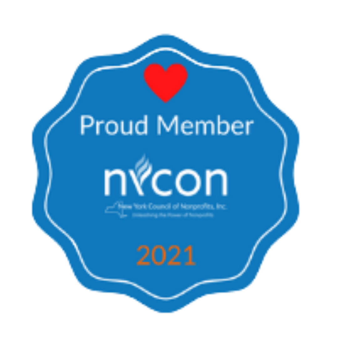 """The 2021 NYCON Badge. It is a blue base with a heart and the words """"Proud Member"""" and """"NYCON"""" along with the year 2021"""