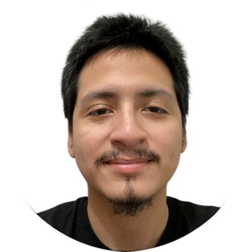 Luiggi smiles directly into the camera. He is latinx, in his early 20s and has a moustache and goatee. He is wearing a black shirt.