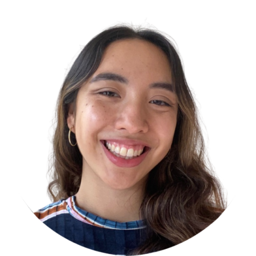 Aileen smiles directly into the camera. She is Mexican-American, in her early 20s and her hair is down and wavy. She's wearing hoop earrings and a striped shirt.